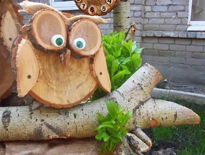 Сова из спилов дерева